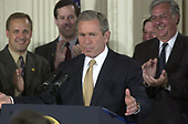 United States President George W. Bush makes remarks before signing into law the 1.35 trillion dollar Tax Cut Bill in the East Room of the White House in Washington, DC on June 7, 2001.  <br /> Credit: Ron Sachs / CNP