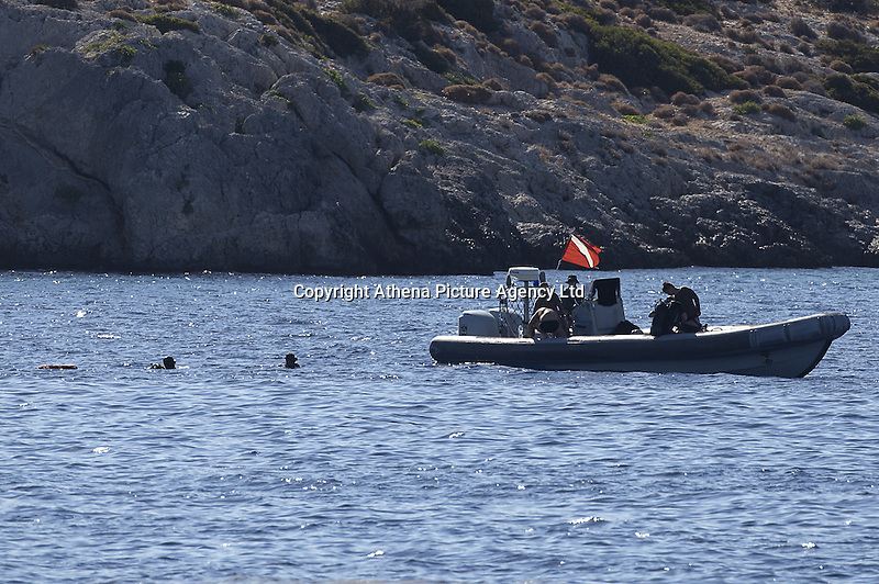 Pictured: Coastguard and other emergency services in Aegina. Tuesday 16 August 2016<br /> Re: Four people, including a nine-year-old child, died and four were injured after a boat with about 20 people on board and a speedboat collided off the Greek holiday island of Aegina near Athens, Greece