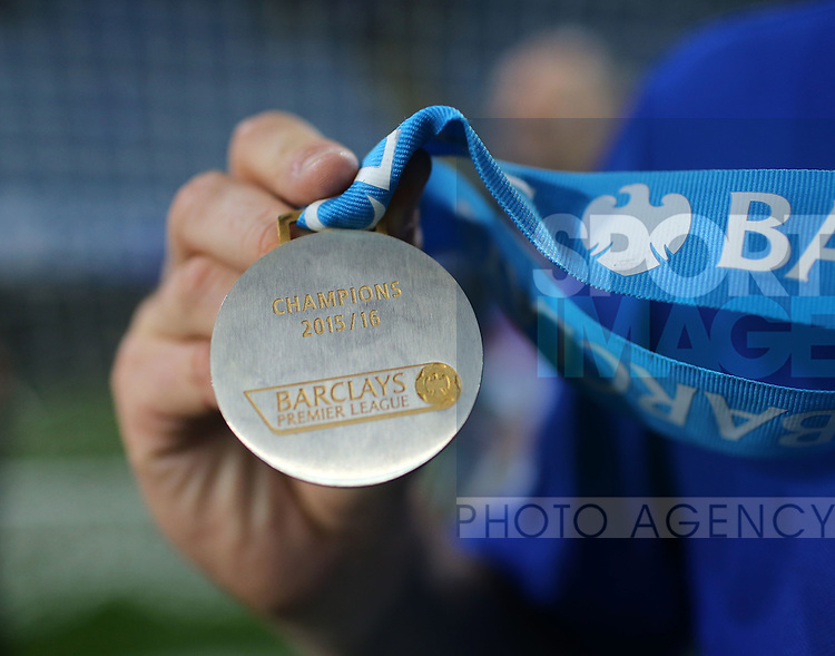 Leicester's Robert Huth?s shows off his winners medal during the Barclays Premier League match at the King Power Stadium.  Photo credit should read: David Klein/Sportimage
