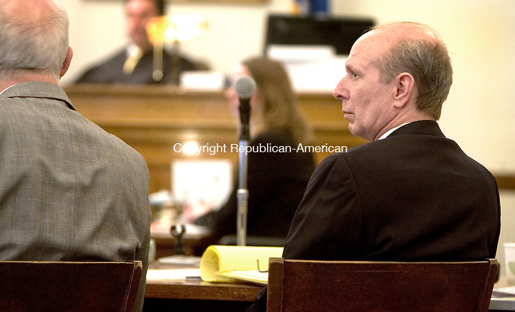 LITCHFIELD, CT. 10 January 2012-011012SV03-Kevin Campbell, right, listens to testimony during his trial in Superior Court in Litchfield Tuesday. Campbell is on trial for allegedly murdering Roland Lagasse in a dispute over membership in the Forbidden Motorcycle Club in Torrington. The incident took place in 2008. .Steven Valenti Republican-American