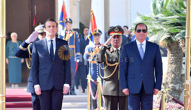 Egyptian President Abdel Fattah al-Sisi and French President Emmanuel Macron listen to national anthems during a welcoming ceremony at the presidential palace Cairo, Egypt, January 28, 2019. Photo by Egyptian President Office \ apaimages