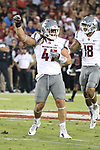 Peyton Pelluer (47), Washington State linebacker, celebrates a huge defensive play during the Cougars Pac-12 Conference road victory over the Stanford Cardinal, 42-16, on October 8, 2016, at Stanford Stadium in Palo Alto, California.