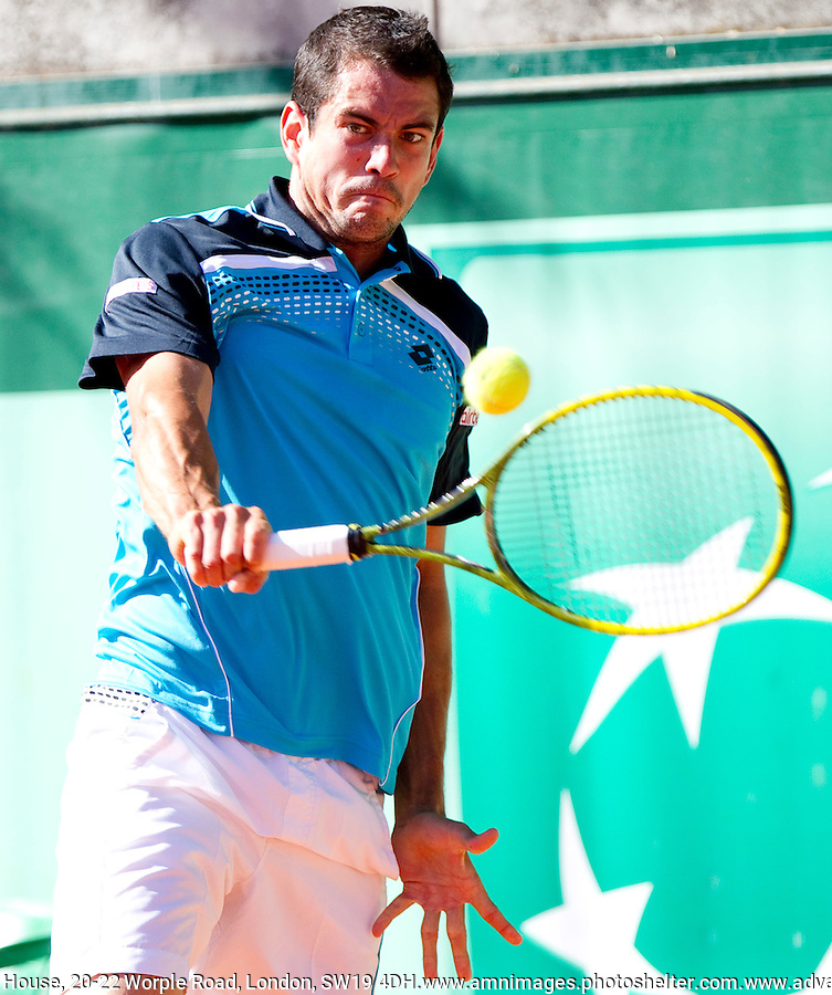 Guiilermo GARCIA-LOPEZ (ESP) against Marsel IHAN (TUR) in the 2nd round of the men's singles. Guillermo Garcia-Lopez beat Marsel Ihan 6-4 1-6 6-2 4-6 13-11..Tennis - Grand Slam - French Open - Roland Garros - Paris - Day 4 -  Wed May 25th 2011..© AMN Images, Barry House, 20-22 Worple Road, London, SW19 4DH, UK..+44 208 947 0100.www.amnimages.photoshelter.com.www.advantagemedianetwork.com.