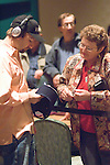 Daniel Negreanu signs an autograph for a fan.