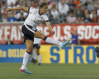 USWNT midfielder Carli Lloyd (10) follows through on a scoring shot.  In an international friendly, the U.S. Women's National Team (USWNT) (white/blue) defeated Korea Republic (South Korea) (red/blue), 4-1, at Gillette Stadium on June 15, 2013.