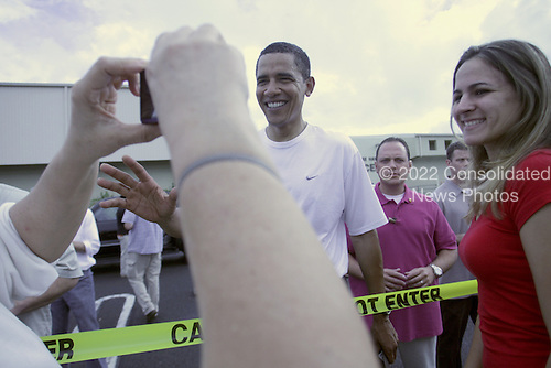 Kailua, HI - January 1, 2009 - United States President-elect Barack Obama greets well-wishers after his morning gym workout at Semper Fit Center at Marine Corps Base Hawaii Kaneohe Bay on Thursday, January 01, 2009 in Honolulu, Hawaii. Obama and his family arrived in his native Hawaii December 20 with his family for the Christmas holiday.  .Credit: Kent Nishimura - Pool via CNP