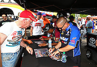 May 31, 2013; Englishtown, NJ, USA: NHRA top fuel dragster driver Brandon Bernstein signing autographs during qualifying for the Summer Nationals at Raceway Park. Mandatory Credit: Mark J. Rebilas-