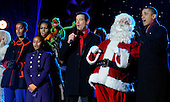 United States President Barack Obama, the First Family, Santa Claus and others sing during the 2011 National Christmas Tree Lighting on the Ellipse in Washington, DC, on Thursday, December 1, 2011. From left are Malia Obama, Sasha Obama, first lady Michelle Obama, Kermit the Frog, Carson Daly, Santa Claus and President Obama. .Credit: Roger L. Wollenberg / Pool via CNP