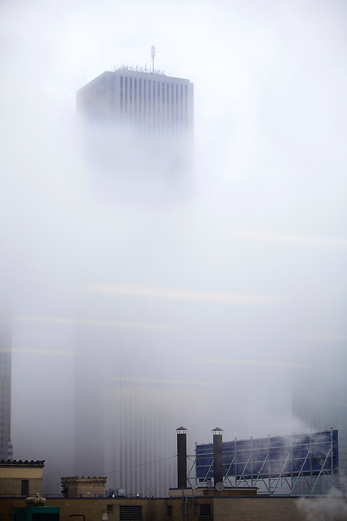 The Aon Center at 200 E Randolph St. peeks its topmost stories out of a thick blanket of clouds in the spring of 2015. (DePaul University/April Sumner)
