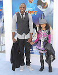Wayne Brady and daughter at The Warber Bros. Pictures'  World Premiere of HAPPY FEET TWO held at The Grauman's Chinese Theatre in Hollywood, California on November 13,2011                                                                               © 2011 Hollywood Press Agency