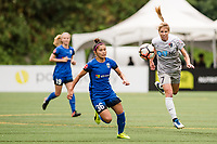 Seattle, WA - Sunday, August 13, 2017: Nahomi Kawasumi and Mccall Zerboni during a regular season National Women's Soccer League (NWSL) match between the Seattle Reign FC and the North Carolina Courage at Memorial Stadium.