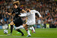 Real Madrid's Spanish midfielder Isco and Paris Saint Germain´s David Luiz
