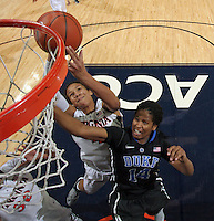 Duke guard Ka'lia Johnson (14) reaches for the rebound next to Virginia center Simone Egwu (4) during an NCAA college basketball game in Charlottesville, Va. Duke defeated Virginia 62-41...