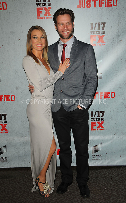 WWW.ACEPIXS.COM . . . . .  ....January 10 2012, LA....Actress Natalie Zea (L) and Travis Schuldt arriving at the premiere of 'Justified' Season 3 at the Directors Guild of America on January 10, 2012 in Los Angeles, California.....Please byline: PETER WEST - ACE PICTURES.... *** ***..Ace Pictures, Inc:  ..Philip Vaughan (212) 243-8787 or (646) 679 0430..e-mail: info@acepixs.com..web: http://www.acepixs.com