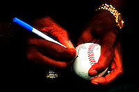 August 7, 2009:  Ernie Banks signs autographs before the Under Armour All-America team game at Wrigley Field in Chicago, IL.  Photo By Mike Janes/Four Seam Images  (EDITORS NOTE:  Levels adjusted in post processing).