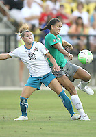 Shannon Boxx #7 of Abby's XI backs into Ramona Bachmann #9 of Marta's XI during the WPS All-Star game at KSU Stadium in Kennesaw, Georgia on June 30 2010. Marta XI won 5-2.