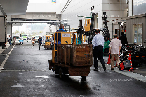 A worker drives a turret truck at the new Tokyo Metropolitan Central Wholesale Market which opened in Toyosu on October 11, 2018, Tokyo, Japan. The new fish market replaces the famous Tsukiji Fish Market which closed for the last time on Saturday 6th October. The move to Toyosu was delayed for almost 2 years because of fears over toxins found in water below the new market. (Photo by Rodrigo Reyes Marin/AFLO)