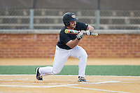 Joey Rodriguez (8) of the Wake Forest Demon Deacons squares to bunt against the Clemson Tigers at David F. Couch Ballpark on March 12, 2016 in Winston-Salem, North Carolina.  The Tigers defeated the Demon Deacons 6-5.  (Brian Westerholt/Four Seam Images)