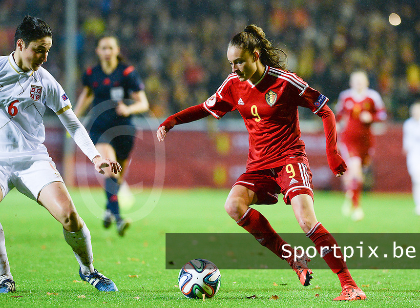 20151130 - LEUVEN ,  BELGIUM : Belgian Tessa Wullaert (9) pictured with Serbian Nevena Damjanovic (left) during the female soccer game between the Belgian Red Flames and Serbia , the third game in the qualification for the European Championship in The Netherlands 2017  , Monday 30 November 2015 at Stadion Den Dreef  in Leuven , Belgium. PHOTO DAVID CATRY