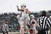 Ohio State Buckeyes tight end Rashod Berry (13) lifts running back Mike Weber Jr. (25) in celebration of Weber's touchdown during the fourth quarter of the NCAA football game against the Michigan State Spartans at Spartan Stadium in East Lansing, Mich. on Nov. 10, 2018. Ohio State won 26-6. [Adam Cairns/Dispatch]