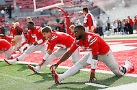 Ohio State Buckeyes quarterbacks J.T. Barrett (16), quarterback Joe Burrow (10) and quarterback Dwayne Haskins (7) stretch prior to the NCAA football game against the Rutgers Scarlet Knights at Ohio Stadium in Columbus on Oct. 1, 2016. Ohio State won 58-0. (Adam Cairns / The Columbus Dispatch)