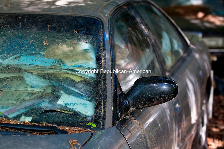 CHESHIRE, CT-062114JS20--A car filled with items sits on the driveway of the Cheshire home of Beverly Mitchell who died last week when a floor collapsed on her. <br /> Jim Shannon Republican-American