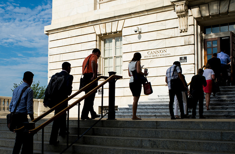 UNITED STATES - JULY 20: Congressional staffers wait in line to enter the Cannon House Office Building on Monday morning, July 20, 2015. (Photo By Bill Clark/CQ Roll Call)