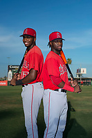 AZL Angels outfielders Trent Deveaux (17) and D'Shawn Knowles (20), both from the Bahamas, pose for a photo before an Arizona League game against the AZL Padres 2 at Tempe Diablo Stadium on July 18, 2018 in Tempe, Arizona. The AZL Padres 2 defeated the AZL Angels 8-1. (Zachary Lucy/Four Seam Images)