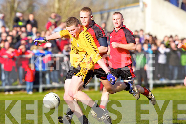Conor Cox of Listowel Emmets goes for goal as Tarbert's Danny Wrenn looks on in the The Bernard O'Callaghan Memorial Senior Football Championship Final replay last Sunday afternoon in Con Brosnan Park, Moyvane
