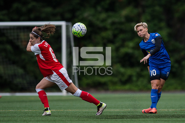 Seattle, WA - Thursday, May 26, 2016: Seattle Reign FC midfielder Jessica Fishlock (10) passes the ball as Vicky Losada (6) of the Arsenal Ladies FC defends. The Seattle Reign FC of the National Women's Soccer League (NWSL) and the Arsenal Ladies FC of the Women's Super League (FA WSL) played to a 1-1 tie during an international friendly at Memorial Stadium.