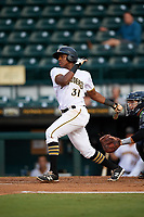 Bradenton Marauders third baseman Ke'Bryan Hayes (31) follows through on a swing during the second game of a doubleheader against the Tampa Yankees on June 14, 2017 at LECOM Park in Bradenton, Florida.  Tampa defeated Bradenton 5-1.  (Mike Janes/Four Seam Images)
