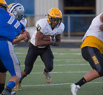 A photograph from the Manogue at McQueen football game played at McQueen High School on Friday, September 1, 2017. Manogue's Peyton Dixon runs.
