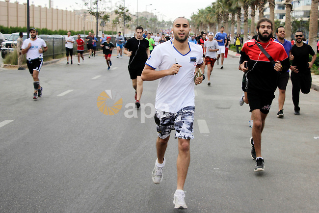 Egyptians run at street during a Marathon to raise awareness and funds to fight breast cancer, in Cairo, Egypt, on Oct. 28, 2016. Photo by Amr Sayed