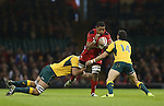Australia lock Rob Simmons and wing Adam Ashley-Cooper stop Wales number 8 Taulupe Faletau.<br /> Dove Men Series 2014<br /> Wales v Australia<br /> Millennium Stadium<br /> 08.11.14<br /> &copy;Steve Pope-SPORTINGWALES
