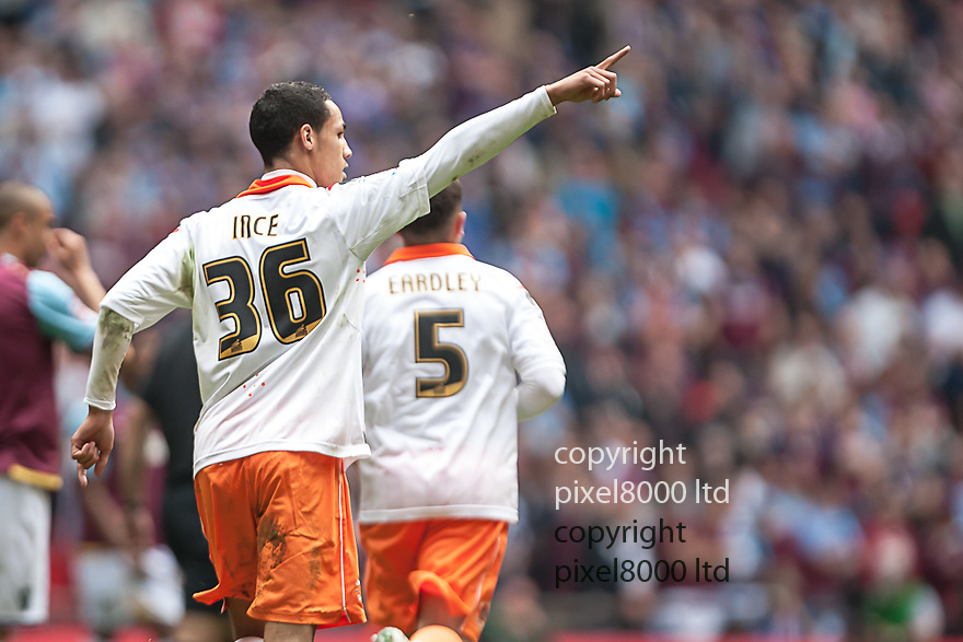 London, UK. Blackpool goalscorer Thomas Ince celebrates his equalising goal during nPower Championship playoff final fixture Blackpool versus West Ham United at Wembley Stadium 19 May.  Please Byline David Fearn Pixel 8000 Ltd