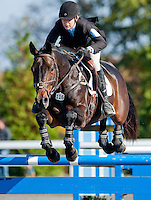 Fernhill Cubalawn, with rider Alexandra Green (USA), competes during the Stadium Jumping test during the Fair Hill International at Fair Hill Natural Resources Area in Fair Hill, Maryland on October 21, 2012.