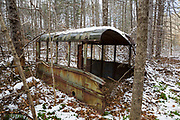Abandoned bus in the forest of Hastings, Maine during the autumn months. This area was part of the Wild River Railroad, which was a logging railroad in operation from 1891 - 1904 +/-.