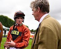Jockey Rob Hornby talks through the race after winning the Dartmouth General Contractors Ltd Handicap (Div 1),  during Afternoon Racing at Salisbury Racecourse on 7th August 2017