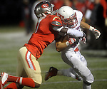 (Everett Ma 091914) Everett 17, Grandhi Deris, grabs Tewksbury James Hirtle, short of the end zone,  during the first quarter of the game, Friday, Sept. 19, 2014, at Everett Stadium. (Jim Michaud Photo) For Saturday