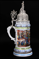 BNPS.co.uk (01202 558833)<br /> Pic: Ratisbons/BNPS<br /> <br /> An ornate beer stein that belonged to one of Donald Trump's German ancestor is being auctioned - suggesting that the famously teetotal Presidents relatives clearly liked a beer.<br /> <br /> The stein is inscribed to 'Infantryman Trump' as well as listing all the other members of his volunteer regiment in the Imperial army just prior to World War One.<br /> <br /> The Trump family was based in Kallstadt which is about 25 miles North of Landau, where the Regiment was based.