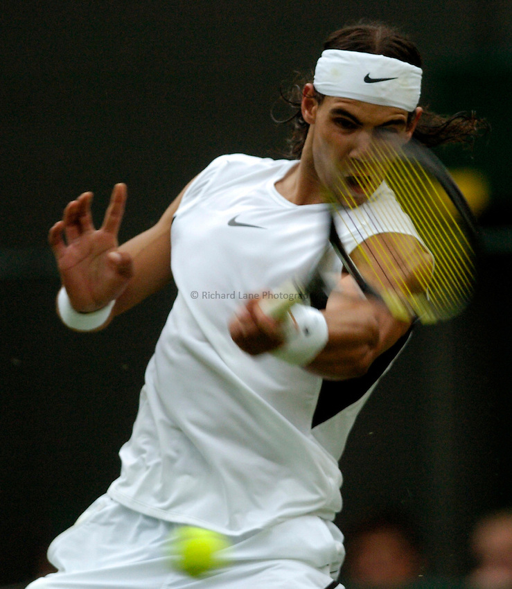 Photo: Richard Lane..Wimbledon Championships. 27/06/2006. .Spain's Raphael Nadal returns during his 1st round match.
