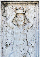 Bas-relief sculpture of a woman with crown located in the Palazzo del Quirinale area, Rome, Italy