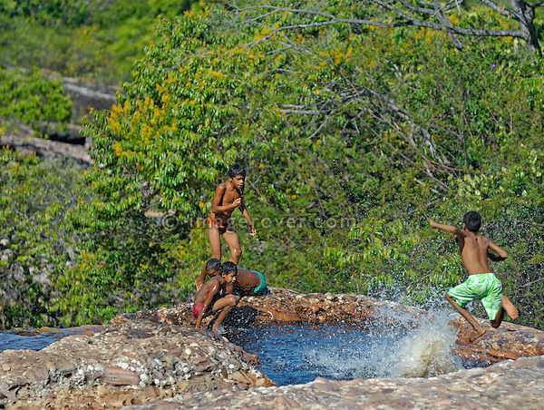 Local brazilian children playing and swimming in one of many Rio Lencois' natural pools; Parque Nacional de Chapada Diamantina, Lencois, Bahia, Brazil. --- No signed releases available.