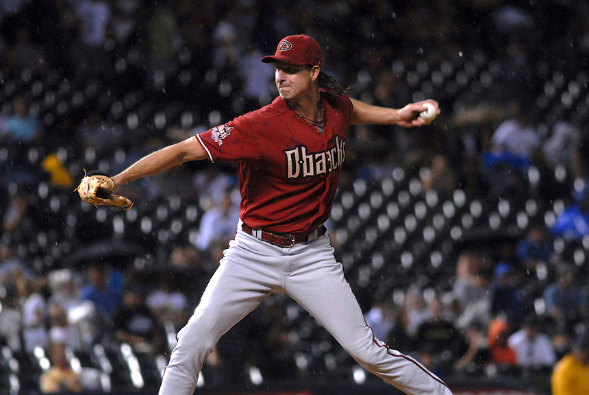 12 August 08: D'backs pitcher Randy Johnson delivers a pitch during a game between the Arizona Diamondbacks and the Colorado Rockies at Coors Field in Denver, Colorado.
