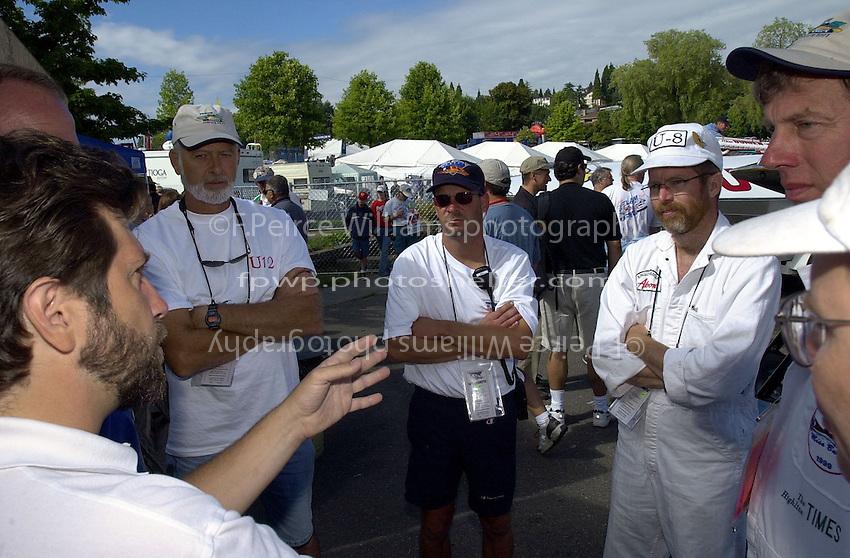 David Williams (left) talks to vintage drivers and crews.