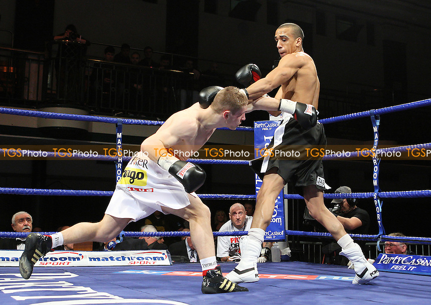 Grzegorz Proksa (white/red shorts) defeats Tyan Booth in a Middleweight boxing contest for the EBU-EU (European Union) Title at York Hall, Bethnal Green, promoted by Barry Hearn / Matchroom Sports - 12/02/10 - MANDATORY CREDIT: Gavin Ellis/TGSPHOTO - Self billing applies where appropriate - Tel: 0845 094 6026