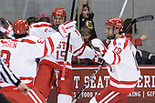 Ben Rosen (BU - 8), Ryan Santana (BU - 15), Justin Courtnall (BU - 19) celebrate Santana's first of the season which made it 3-0 BU in the first. - The Boston University Terriers defeated the visiting Providence College Friars 6-1 on Friday, January 20, 2012, at Agganis Arena in Boston, Massachusetts.
