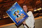 Perez Hilton holds up his Tweetup poster for his birthday celebration at TAO, Las Vegas, NV, April 1, 2010 © Al Powers / RETNA ltd