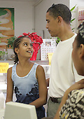 HAWAII KAI, HI - DEC 26: United States President-elect Barack Obama's eyes meet with the eyes of his oldest daughter, Malia, in Kokonuts Shave Ice and Snacks at Koko Head Marina shopping mall while ordering shave ice Friday, December 26, 2008 in Honolulu, Hawaii. .Credit: Kent Nishimura - Pool via CNP