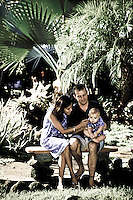Couple and baby in tropical garden, Hawaii